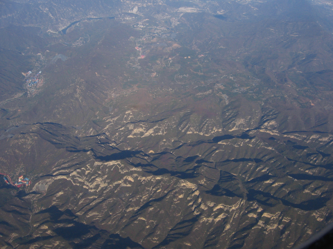 These barren mountains northwest of Beijing also show signs of human activity. This was not true for the vast desert of Mongolia farther to the north.